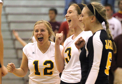 Mike Greene - mgreene@shawmedia.com Jacobs' Mackenzie Traub (left), Alyssa Ehrhardt, and Kassie Kasper celebrate winning a point during the second set of a conference match against Prairie Ridge Tuesday, September 18, 2012 at Prairie Ridge High School in Crystal Lake. Prairie Ridge (4-0) defeated Jacobs (3-1) in three sets to remain undefeated in the conference.