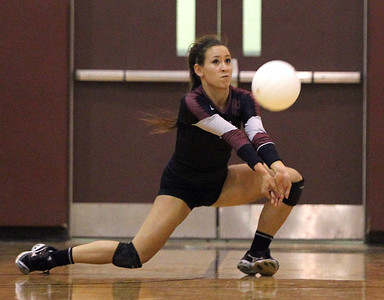 Mike Greene - mgreene@shawmedia.com Prairie Ridge's Paige Dacanay digs a serve during the first set of a conference match against Jacobs Tuesday, September 18, 2012 at Prairie Ridge High School in Crystal Lake. Prairie Ridge (4-0) defeated Jacobs (3-1) in three sets to remain undefeated in the conference.