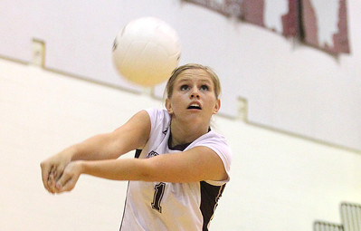 Mike Greene - mgreene@shawmedia.com Prairie Ridge's Caitlin Brauneis bumps the ball during the second set of a conference match against Jacobs Tuesday, September 18, 2012 at Prairie Ridge High School in Crystal Lake. Prairie Ridge (4-0) defeated Jacobs (3-1) in three sets to remain undefeated in the conference.