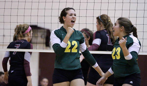 Mike Greene - mgreene@shawmedia.com Crystal Lake South's Kylie Portera cheers alongside teammate Lindsey Murphy after scoring a point during a match against Prairie Ridge Thursday, September 13, 2012 at Prairie Ridge High School in Crystal Lake. Prairie Ridge came back after losing the first set to win the match.