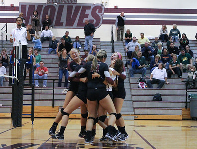 Mike Greene - mgreene@shawmedia.com Members of the Prairie Ridge volleyball team celebrate after coming back to defeat Crystal Lake South in a match Thursday, September 13, 2012 at Prairie Ridge High School in Crystal Lake. Prairie Ridge came back after losing the first set to win the match.