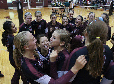 Mike Greene - mgreene@shawmedia.com Prairie Ridge's Caitlin Braunei (right) talks to teammate Ali Witt (left) as  Paige Dacanay (center) smiles after a comeback win against Crystal Lake South Thursday, September 13, 2012 at Prairie Ridge High School in Crystal Lake. Prairie Ridge came back after losing the first set to win the match.