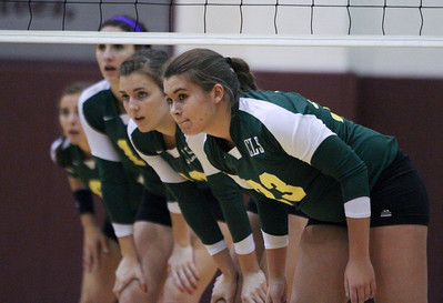 Mike Greene - mgreene@shawmedia.com Crystal Lake South's Lindsey Murphy and teammates await a serve during a match against Prairie Ridge Thursday, September 13, 2012 at Prairie Ridge High School in Crystal Lake. Prairie Ridge came back after losing the first set to win the match.