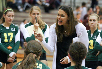 Mike Greene - mgreene@shawmedia.com Crystal Lake South head coach Jorie Fontana talks to her players after losing the second set during a match against Prairie Ridge Thursday, September 13, 2012 at Prairie Ridge High School in Crystal Lake. Prairie Ridge came back after losing the first set to win the match.