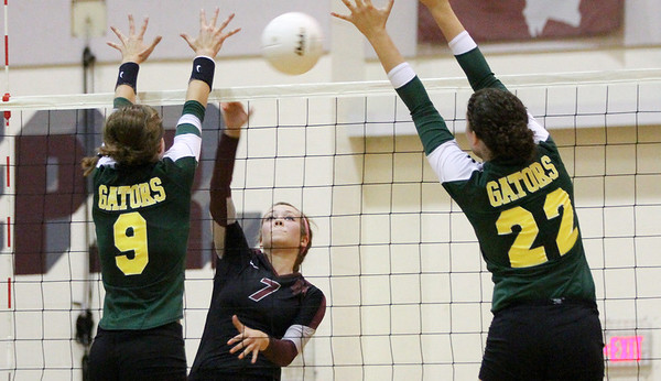Mike Greene - mgreene@shawmedia.com Crystal Lake South's Nicole Jurkash (left) and Kylie Portera (right) attempt to block a shot by Prairie Ridge's Taylor Otto during a match Thursday, September 13, 2012 at Prairie Ridge High School in Crystal Lake. Prairie Ridge came back after losing the first set to win the match.