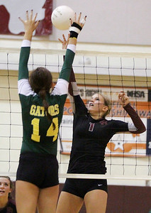 Mike Greene - mgreene@shawmedia.com Prairie Ridge's Caitlin Brauneis (right) goes up to put a shot over the net while Crystal Lake South's Avalon Nero prepares to block during a match Thursday, September 13, 2012 at Prairie Ridge High School in Crystal Lake. Prairie Ridge came back after losing the first set to win the match.