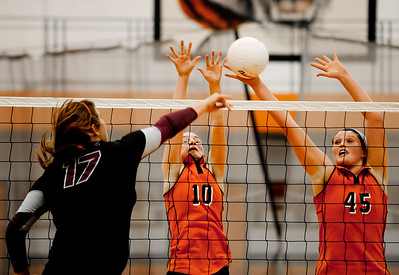 Josh Peckler - Jpeckler@shawmedia.com Crystal Lake Central's Lauren Leverenz (45) and Natalie Ricca (10) attempt to block a attack from Prairie Ridge's Maddie Drain Tuesday, September 11, 2012 at Crystal Lake Central. Prairie Ridge defeated Central 2-0.