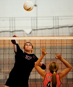 Josh Peckler - Jpeckler@shawmedia.com Prairie Ridge's Maddie Drain (17) goes up to attack the ball against Crystal Lake Central's Susan Jeziorowski Tuesday, September 11, 2012 at Crystal Lake Central. Prairie Ridge defeated Central 2-0.