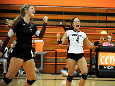 Josh Peckler - Jpeckler@shawmedia.com Prairie Ridge libero Paige Dacanay (4) and Caitlin Brauneis celebrate a point against Crystal Lake Central Tuesday, September 11, 2012 at Crystal Lake Central. Prairie Ridge defeated Central 2-0.