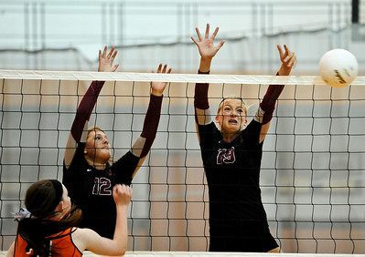 Josh Peckler - Jpeckler@shawmedia.com Prairie Ridge's Ali Witt (19) and Mackenzie Humm (12) block a attack from Crystal Lake Central's Kelly Harkins Tuesday, September 11, 2012 at Crystal Lake Central. Prairie Ridge defeated Central 2-0.