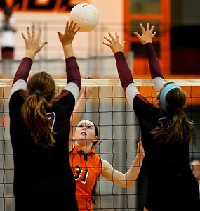 Josh Peckler - Jpeckler@shawmedia.com Crystal Lake Central's Kelley Harkins (31) tips the ball over Prairie Ridge blockers Maddie Drain (left) and Mackenzie Humm Tuesday, September 11, 2012 at Crystal Lake Central. Prairie Ridge defeated Central 2-0.