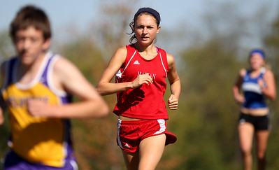 Mike Greene - mgreene@shawmedia.com Marian Central's Jessica Biggins runs during Flight 5 of the Ryan Byrne Fest 2012 Saturday, September 15, 2012 at Emricson Park in Woodstock. Biggins finished in third place in the girls section of the flight.