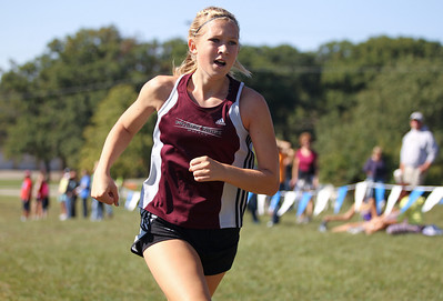 Mike Greene - mgreene@shawmedia.com Prairie Ridge's Ashley Duda runs near the finish line during Flight 5 of the Ryan Byrne Fest 2012 Saturday, September 15, 2012 at Emricson Park in Woodstock. Duda took second place in the girls section of the flight.