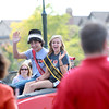 St. Charles East Homecoming co-King and Queen Matt Beth and Kelsey Talken wave to the crowd during the parade on Illinois Street Friday afternoon.(Sandy Bressner photo)