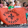 Elementary school students watch the St. Charles East homecoming parade on Illinois Street Friday afternoon.(Sandy Bressner photo)