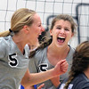 Jeff Krage – For the Kane County Chronicle<br /> St. Charles North's Alex Stone, right, celebrates a point during Tuesday's match against visiting Geneva.<br /> St. Charles 9/18/12