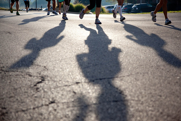 Runners of the Fox Valley Marathon make their way through Geneva early Sunday morning. (Rena Naltsas photo for the Kane County Chronicle)