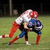 Marmion's Seth Sevenich (82) is taken down by Ryan Hickey of Marian Central during their game in Aurora Friday night.  (Sandy Bressner Photo)