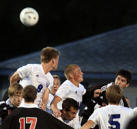 Jeff Krage – For the Kane County Chronicle<br /> Batavia and Geneva soccer players battle for a header near the Geneva goal during Thursday's game at Geneva.<br /> Geneva 9/20/12