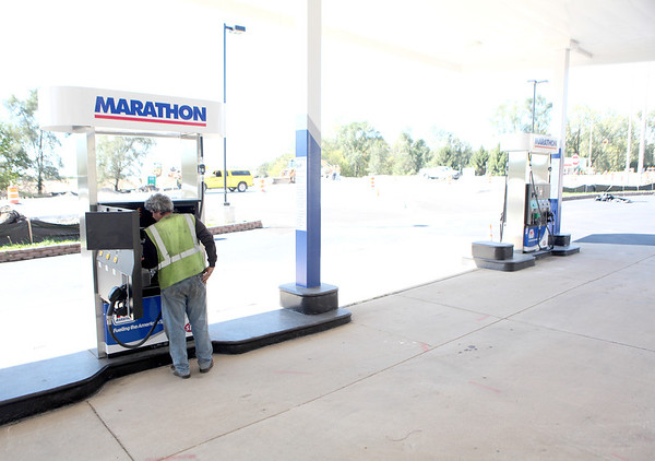 Ed Bishton of Anderson Pump Service checks the gas pumps at the Marathon gas station and convenience store at Routes 64 and 47 in Lily Lake before they were officially turned on Tuesday afternoon. The station had been shuttered for about four years.(Sandy Bressner Photo)