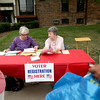 Jean Pierce (right) and Barbara King of the League of Women Voters registers residents of Batavia Apartments to vote during a voter registration drive at the complex.(Sandy Bressner Photo)