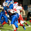 Marmion's Jake Ruddy runs with the ball during their home game against Marian Central Friday night.(Sandy Bressner Photo)