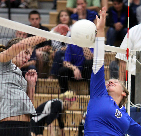 Jeff Krage – For the Kane County Chronicle<br /> Geneva's Nicole Schneider fails to block a hit by St. Charles North's Taylor Krage during Tuesday's match.<br /> St. Charles 9/18/12