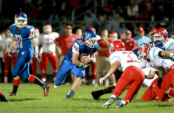 Marmion's Jordon Glasgow runs with the ball during their home game against Marian Central Friday night.(Sandy Bressner Photo)