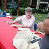 Jean Pierce of the League of Women Voters registers a resident of Batavia Apartments to vote during a voter registration drive at the complex.(Sandy Bressner Photo)