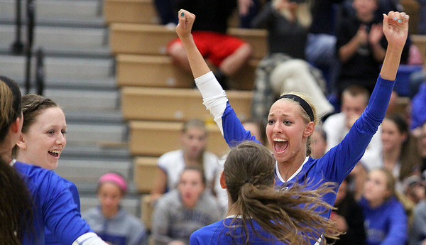 Jeff Krage – For the Kane County Chronicle<br /> Geneva's Sammy Gola celebrates the Vikings straight-set victory Tuesday at St. Charles North.<br /> St. Charles 9/18/12