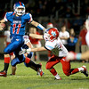 Marmion quarterback Brock Krueger keeps the ball during their home game against Marian Central Friday night.(Sandy Bressner Photo)