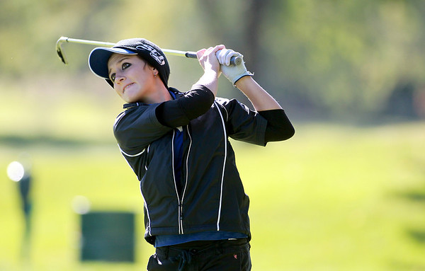 St. Charles North's Ariana Furrie tees off during the Upstate Eight Conference girls golf meet at St. Andrews Golf and Country Club in West Chicago Monday morning.