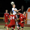 Phillip LeGare (11) of St. Charles North heads the ball during their Tri-City Shootout game Tuesday night against Batavia at St. Charles East.