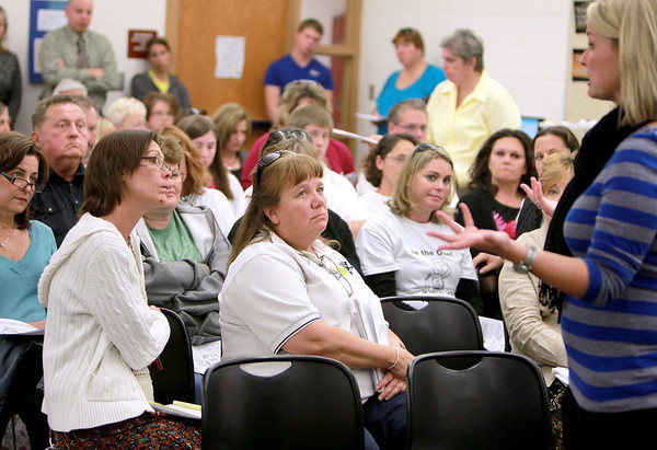 Kaneland Community Unit School District 302 parents, community members, teachers and administrators listen as middle school counselor Denise Michels talks about bullying during a forum prior to the district's school board meeting Monday evening.