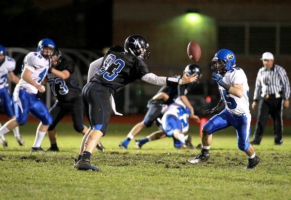 Garrett Johnson of St. Charles North (83) completes a one-handed catch during their home game against Geneva Friday night.