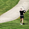 St. Charles East's Paige Jordan hits from the rough during the Upstate Eight Conference girls golf meet at St. Andrews Golf and Country Club in West Chicago Monday morning.