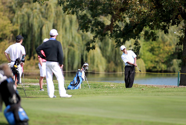 St. Charles North's Raghav Cherala chips onto the 18th green during the Upstate Eight Conference River Division golf meet Wednesday morning at St. Andrew's Golf and Country Club in West Chicago.