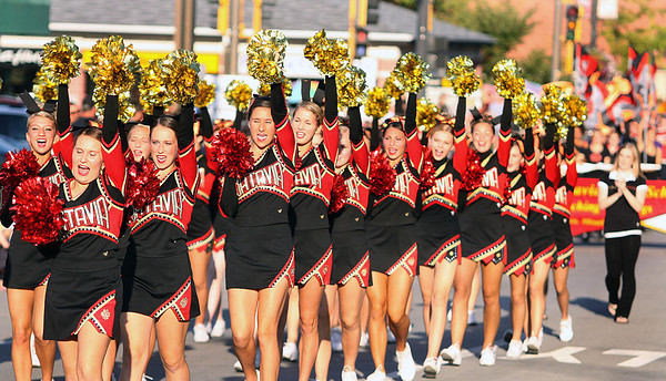 Batavia High School cheerleaders march in Wednesday's homecoming parade.<br />  (Jeff Krage photo for the Kane County Chronicle)