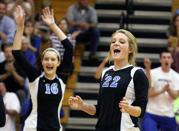 Geneva's Maddie Courter celebrates winning the first set over Batavia during Tuesday's match.<br />  (Jeff Krage photo for the Kane County Chronicle)