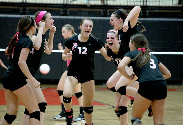 St. Charles East players celebrate their 25-21, 25-12 win over St. Charles North Tuesday night. (Sandy Bressner photo)
