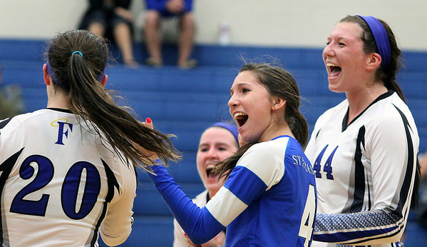 St. Francis' Samantha Dubiel (#4) and Madeline Haggerty (#44) celebrate their three-set victory over Rosary on Monday.<br />  (Jeff Krage photo for the Kane County Chronicle)