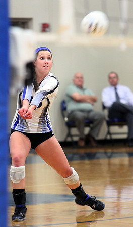 Jeff Krage – For the Kane County Chronicle<br /> St. Francis' Michelle McLaughlin bumps the ball during Monday's match against Rosary.<br /> Wheaton 9/10/12