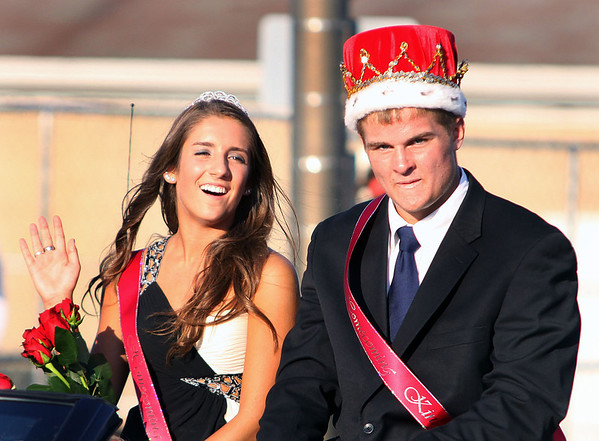 Batavia High School king Mickey Watson and queen Shannon McGee ride in Wednesday's homecoming parade.<br />  (Jeff Krage photo for the Kane County Chronicle)
