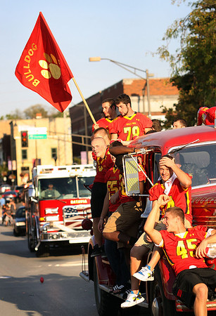 The Batavia High School varsity football team rides in Wednesday's homecoming parade.<br />  (Jeff Krage photo for the Kane County Chronicle)