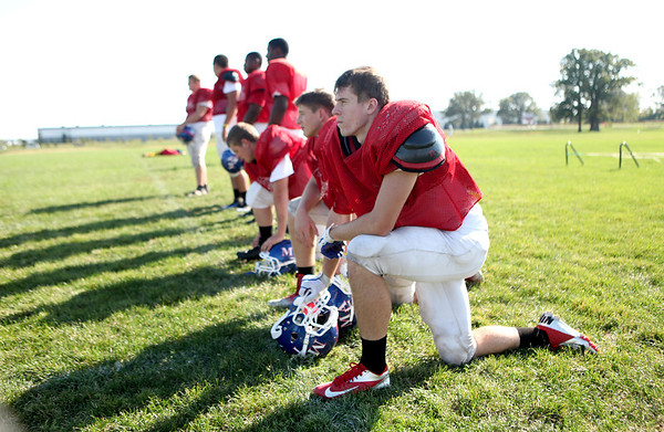 "Marmion's Jake Ruddy (far right) and Tom Jude (second from right) watch as special teams practice at the Aurora school Wednesday afternoon. Marmion coach Dan Thorpe has called the secondary of Charlie Faunce, Jake Ruddy, Tyler Eberth and Tom Jude the ""best hitting group"" he's had in eight years. (Sandy Bressner photo)"