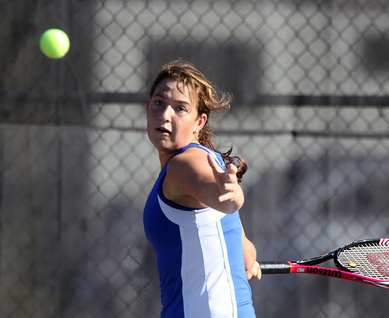 Geneva's Kirby Einck waits to hit a return during Saturday's tennis invitational at St. Charles East High School.<br />  (Jeff Krage photo for the Kane County Chronicle)