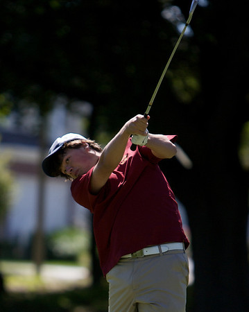 Montini's Seth Maack eyes his shot on Saturday morning at the Batavia Invotational at Fox Valley Golf Club. (Karen Naess photo for the Kane County Chronicle)