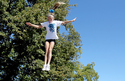 Sarah Nader - snader@shawmedia.com Skyler Hansen, 11, of Johnsburg  performs a flip with the LXC cheerleading team during the Saufen und Spiel parade in Johnsburg on Sunday, September 9, 2012.