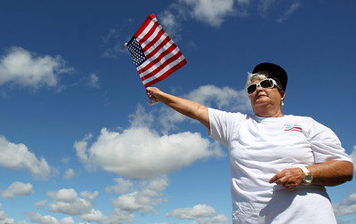 Sarah Nader - snader@shawmedia.com Martha Mirek of Huntley waves an American flag while participating in the Now or Never Rally put on by the Huntley area TEA Party on the corner of Del Webb Boulevard and Route 47 in Huntley on Saturday, September 8, 2012.