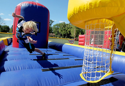 Sarah Nader - snader@shawmedia.com Jarett Polep, 11, of Johnsburg plays a game on the bungee basketball pull while attending Saufen und Spiel in Johnsburg on Sunday, September 9, 2012.
